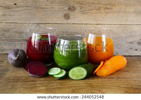 assorted fresh juices from fruits and vegetables - stock photo