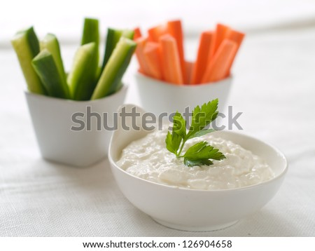 Assorted fresh vegetables with dip, selective focus - stock photo