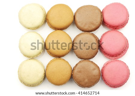 assorted freshly baked macarons on a white background - stock photo