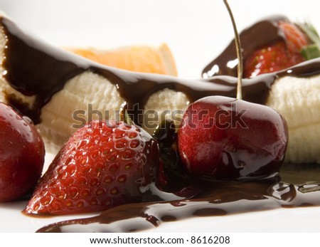 assorted fruits and chocolate sauce still life isolated over white background