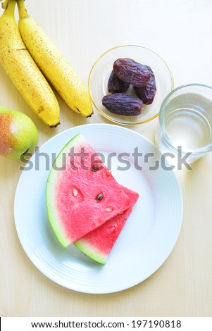 Assorted fruits and glass of water - top angle - stock photo