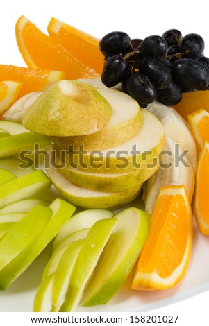 Assorted fruits of orange, apple, grapes and pears.