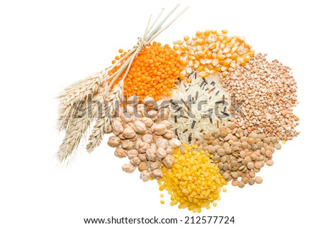 Assorted grains: wild rice, lentils, buckwheat, chickpeas and corn  with wheat ears. Selective focus. - stock photo