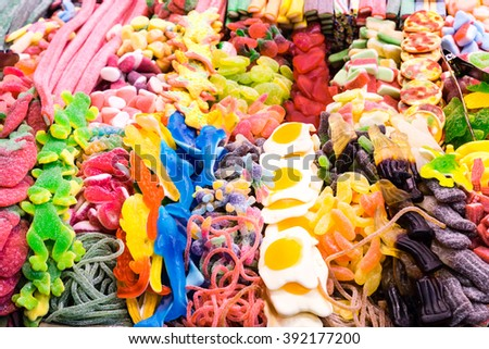 assorted gummy candies on display - stock photo