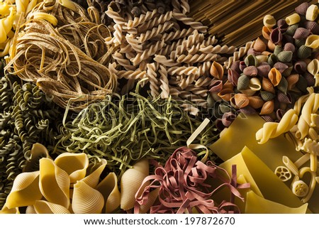 Assorted Homemade Dry Italian Pasta on a Background - stock photo