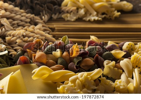 Assorted Homemade Dry Italian Pasta on a Background
