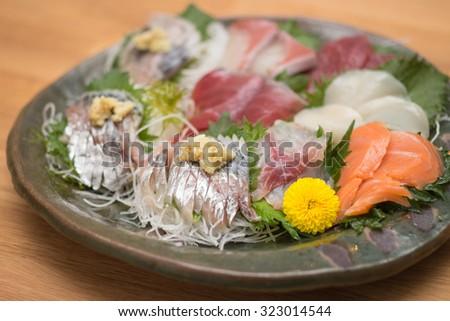 Assorted Japanese sashimi raw fish plate - stock photo