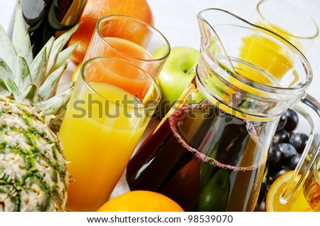 assorted juices and fruit - stock photo