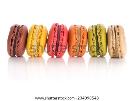 Assorted macaroons. Flavors from left to right: chocolate, lemon, raspberry, salted caramel, matcha, and earl gray tea  - stock photo