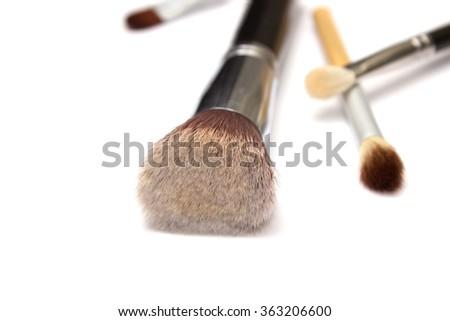 Assorted make up brushes on white isolated background - stock photo