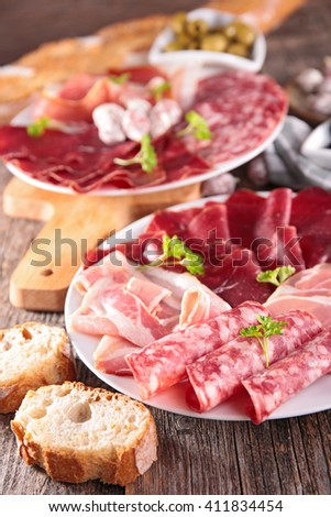 assorted meat and delicatessen - stock photo