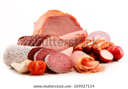 Assorted meat products including ham and sausages isolated on white - stock photo