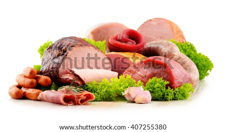 Assorted meat products including ham and sausages isolated on white background - stock photo