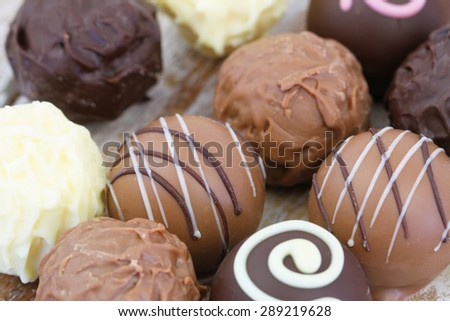 Assorted milk, white and dark chocolates, close up