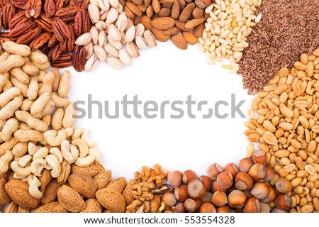 Assorted mixed nuts on white background.