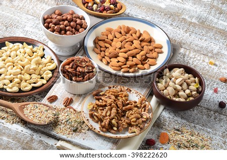 Assorted mixed nuts on wooden table.  - stock photo