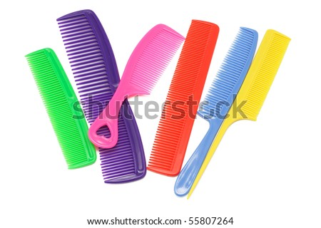 Assorted multicolor plastic combs on white background