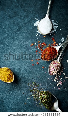 Assorted natural spices on old spoons   - stock photo