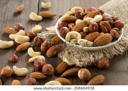 Assorted nuts (almonds, hazelnuts, cashews, peanuts) - stock photo