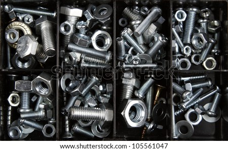Assorted nuts and bolts in plastic box