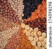 Assorted nuts and dried fruits background - stock photo