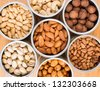 Assorted nuts in Iron pot (pecan, pistachios, almond, peanut, cashew,Pine nuts) - stock photo