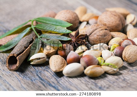 Assorted nuts on a wooden table - stock photo