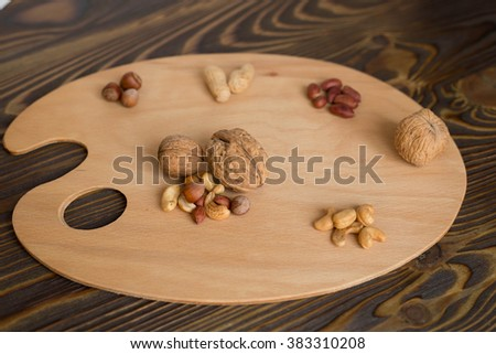 Assorted nuts on the palette - healthy food