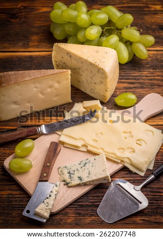 Assorted of cheese with grapes - stock photo