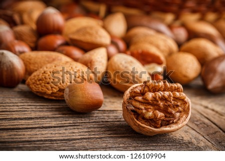 Assorted of whole and chopped nuts - stock photo