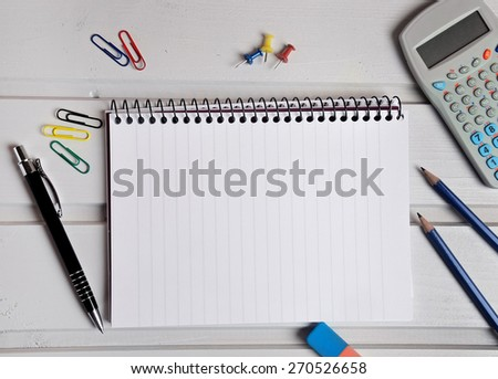 Assorted office supplies on table