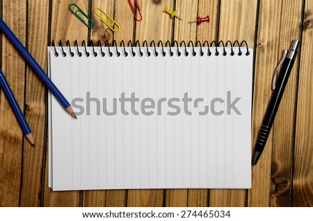 Assorted office supplies on wooden table - stock photo