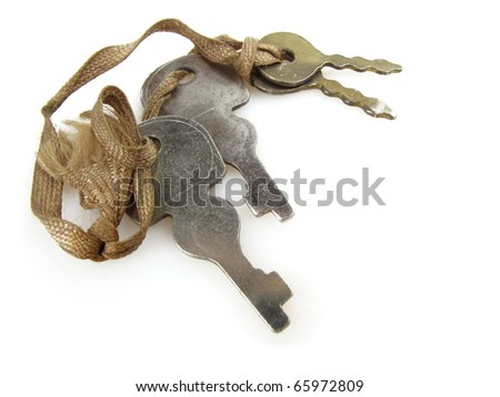Assorted old keys tied with a string on a white background