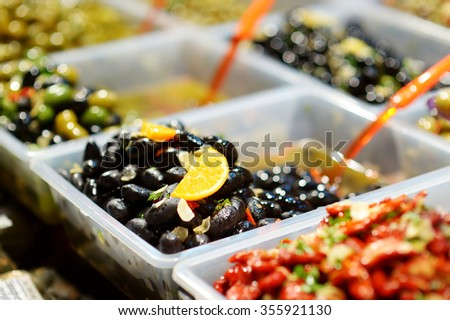 Assorted olives on farmer's market in small town in Italy - stock photo