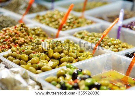 Assorted olives on farmer's market in small town in Italy