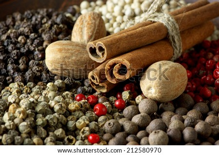 Assorted pepper, cinnamon and nutmeg close-up. - stock photo