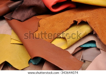 Assorted pieces of skin. Rawhide. Leather pieces. Pieces of colored leather. - stock photo
