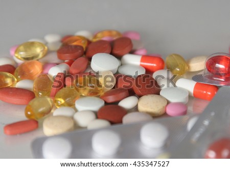 Assorted pills on the table.