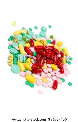 Assorted pills on white background, medical means