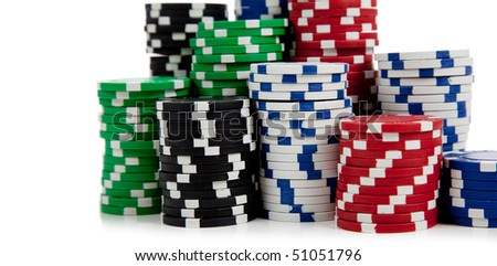 Assorted poker chips including black, white, green, blue and red on a white background