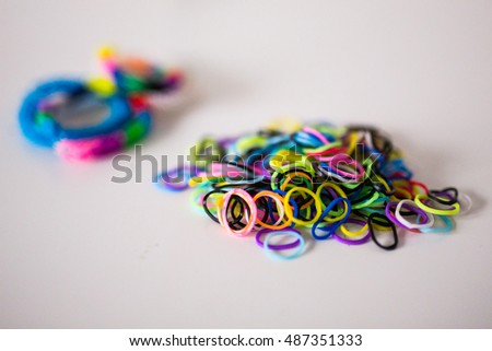 Assorted rainbow loom bands and bracelets
