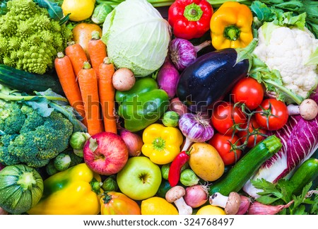 Assorted raw vegetables and fruits background.