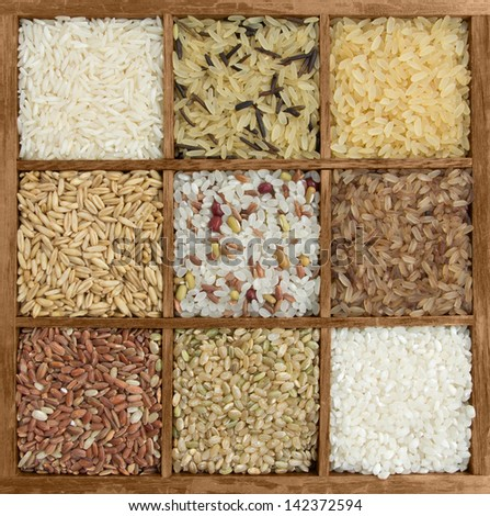 Assorted rice in a wooden box - stock photo