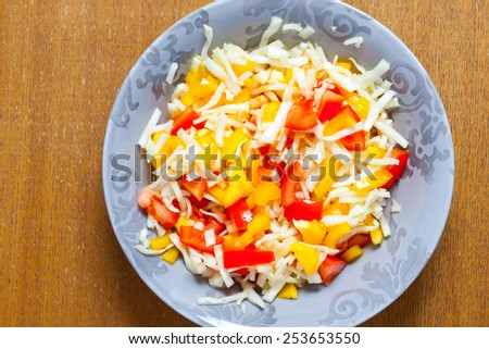 Assorted salad with bell peppers, cabbage and tomatoes in plate - stock photo