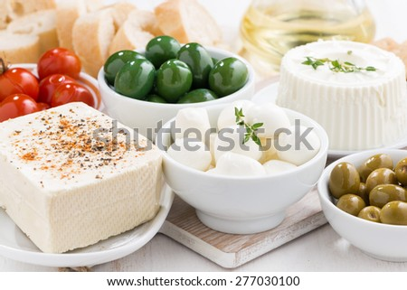 Assorted soft cheeses and pickles, horizontal - stock photo