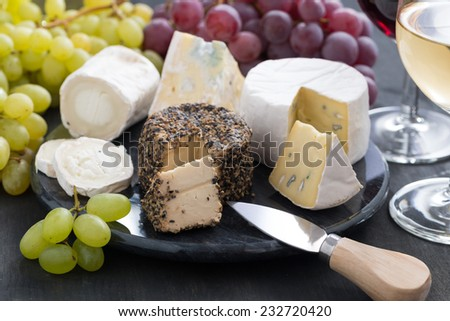 assorted soft cheeses and snacks to wine, close-up - stock photo