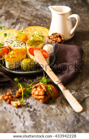 Assorted soft cream cheese goat on stone backgrounds. - stock photo