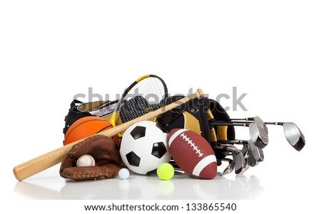 Assorted sports equipment on a white background with copy space - stock photo