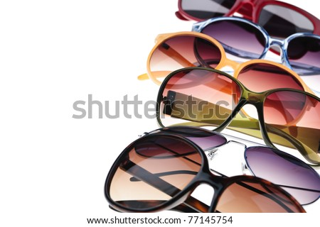 Assorted styles of tinted sunglasses on white background - stock photo