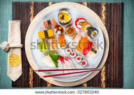 Assorted Sushi Plate with Chopsticks - top-down view - stock photo